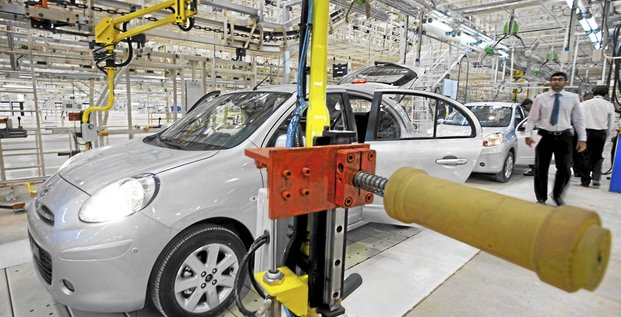 Visitors take a look over a Nissan Motor Co. Micra vehicle on the assembly line of the Renault Nissan Alliance plant during its inauguration in Chennai, India, on Wednesday, March 17, 2010. Nissan Motor Co. may work with Indian truckmaker Ashok Leyland Ltd. on small passenger cars in the Japanese co