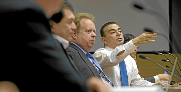 Carlos Ghosn, president and chief executive officer of Nissan Motor Co., gestures during a meeting with members of the company's electric car steering committee at the automaker's headquarters in Yokohama, Japan, on Monday, Oct. 19, 2009. Ghosn, 55, who turned Nissan into the most profitable of the