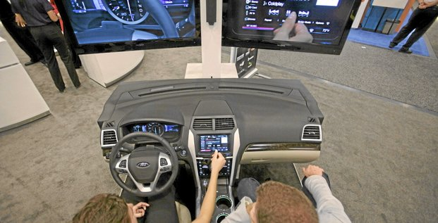 An attendee tries a demonstration of Ford Motor Co.'s Sync information and entertainment system during the CTIA Enterprise & Applications conference at the Moscone Center in San Francisco, California, U.S., on Thursday, Oct. 7, 2010. Ford announced the release of a software kit that will allow devel