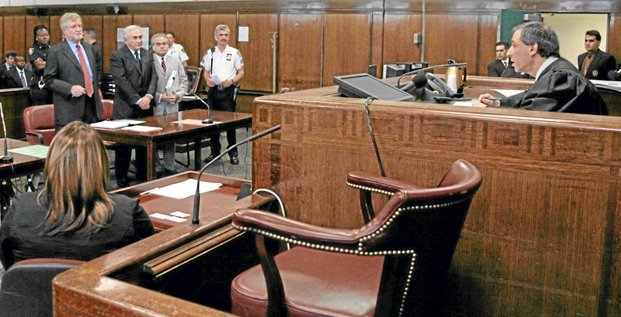 Former IMF chief Dominique Strauss-Kahn (2nd L) appears before before Judge Michael Obus (R) in New York Supreme Court during his arraignment hearing in New York June 6, 2011. Strauss-Kahn entered a plea of not guilty to sexual assault charges and will appear in court again on July 18. REUTERS/Allan