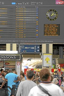 An information board informs Societe Nationale des Chemins de Fer (SNCF) passengers of train schedules at Gare de Lyon train station in Paris, France, on Sunday, Aug. 29, 2010. French railroad company SNCF had a 'very small profit' for the first half of 2010, Chairman Guillaume Pepy said. Photograph