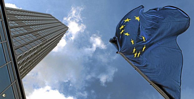 A European Union (EU) flag flies in front of the European Central Bank's (ECB) headquarters in Frankfurt, Germany, on Wednesday, Aug. 10, 2011. The European Central Bank bought Spanish and Italian government bonds, according to people with knowledge of the transactions. Photographer: Hannelore Foers