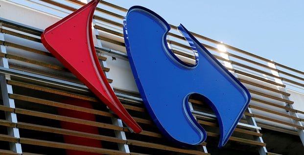 Carrefour releve son objectif d'economies, benefice en hausse de 29% au 1er semestre