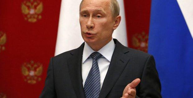 Vladimir Poutine pour le report du référendum de l'Est ukrainien