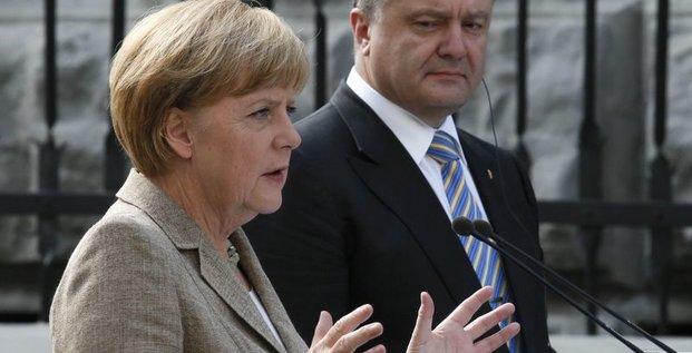 Merkel appelle Kiev et Moscou à s'engager sur un plan de paix