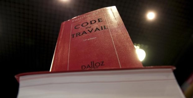 Copies of french labour code are displayed in a specialized bookshop in paris