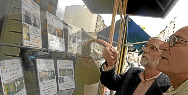Two men look at property for sale at a real estate agent office in Paris, France, Wednesday, March 30, 2005. Photographer: Andrew Wheeler/Bloomberg News