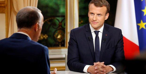 Macron defend ses cinq premiers mois de quinquennat