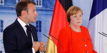 Migrants: merkel et macron demandent une reponse europeenne