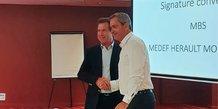 André Deljarry, président du MBS, et Samuel Hervé, président du Medef Montpellier, lors de la signature de l'accord