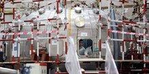 Chine / fusion nucléaire : des hommes travaillent sur le réacteur Tokamak HL-2M, dans la province du Sichuan le 5 juin 2019