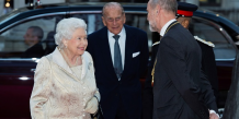La reine d'Angleterre, Elizabeth II et son mari le Prince Philippe arrivant à une réception