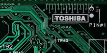 Toshiba intensifie les discussions avec bain